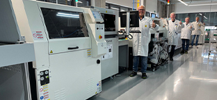 Panasonic Smart Factory Solutions. Workers at large equipment