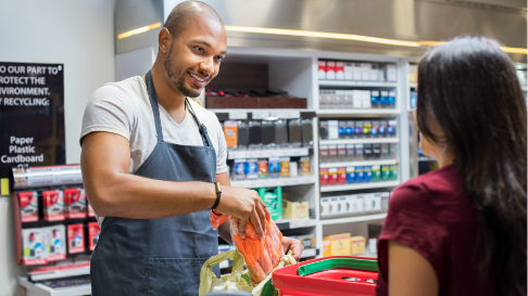 Man chicking out groceries at a store